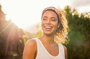 Woman smiling with healthy gums and healthy lifestyle