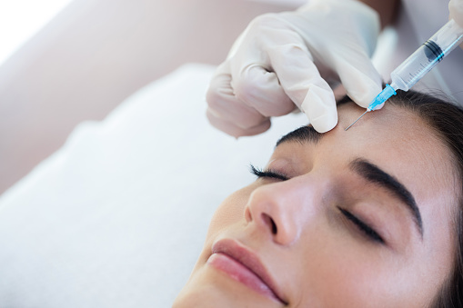 A woman taking botox for treating migranes at Optimum Oral Surgery Group
